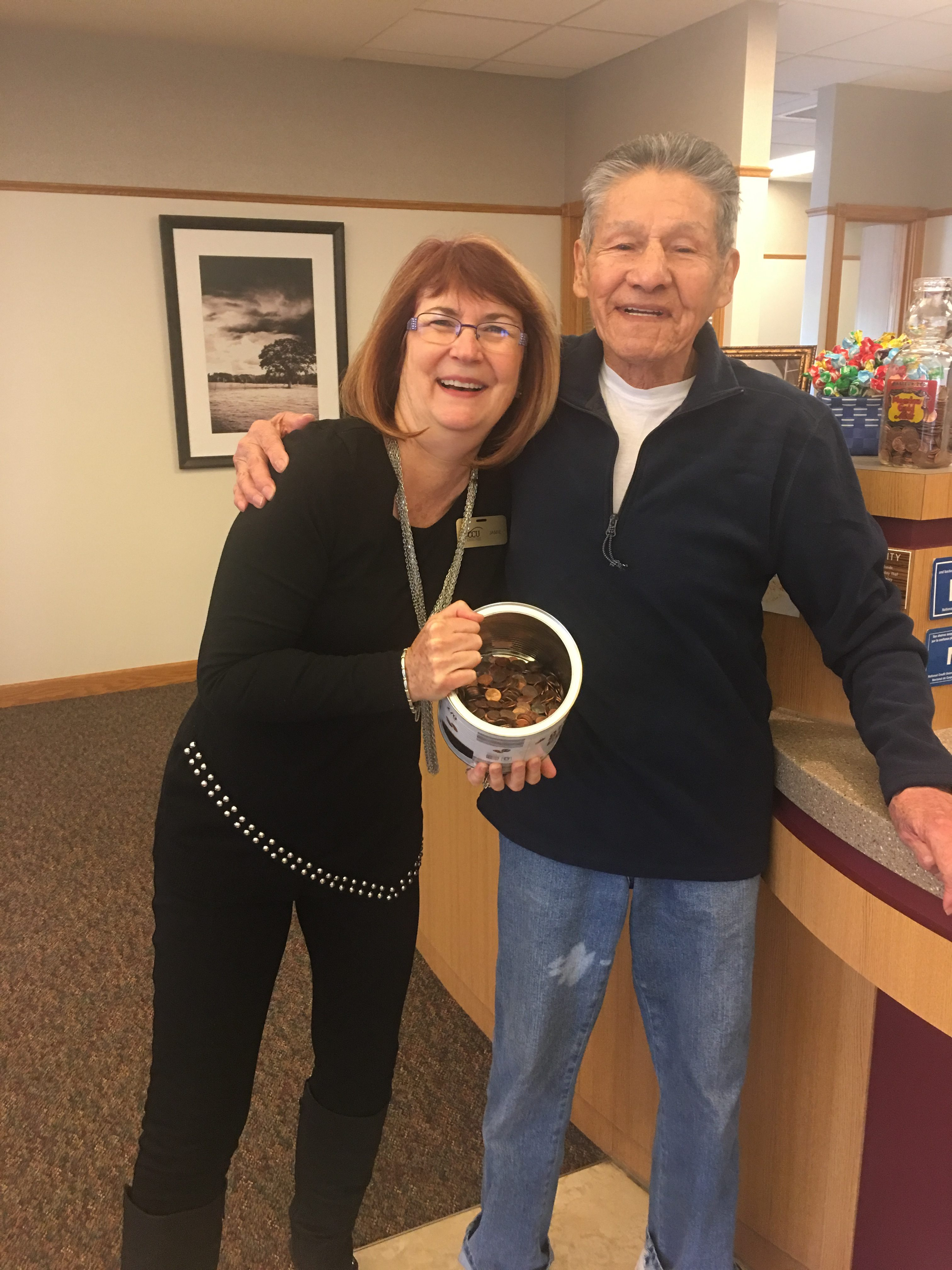 A member in Lake Delton (pictured with WCCU staff member Jamie Hegel) brought in a large crock of pennies for CMN.